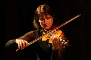 A violinist with her violin.